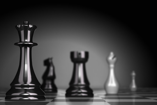 Chess Game over black background, illustration of business strategy or positioning